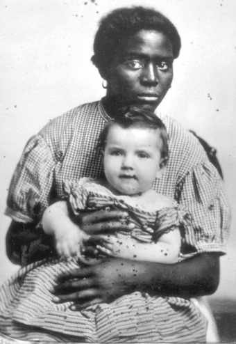 A slave nurse with her mistress's son on her lap, 1850 (Copyright: Scanpix)